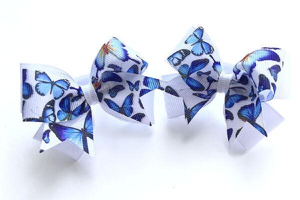 Бант для девочек Ассоль белый с синими бабочками